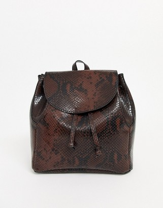 ASOS DESIGN mini soft minimal backpack in snake