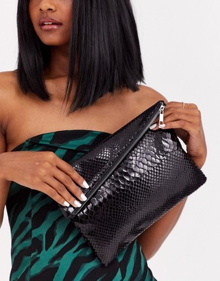 Asos Design DESIGN asymmetric clutch in snake-Black