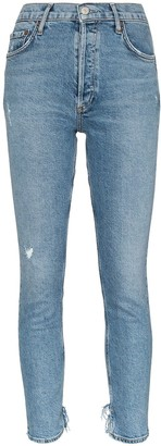 A Gold E Agolde cropped distressed jeans