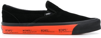 Vans Slip On Trainers With Logo Sole