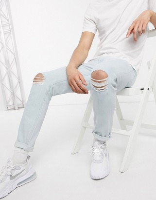 ASOS DESIGN stretch slim jeans in light wash with knee rips