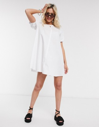 ASOS DESIGN cotton trapeze mini smock dress with ruched sleeves in white
