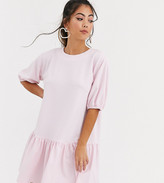 Asos DESIGN Petite textured smock dress with tiered hem in pink