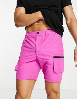 ASOS DESIGN slim nylon shorts with cargo pockets in hot pink