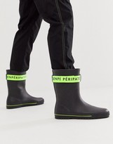 Asos Design DESIGN wellies in black with green tape detail