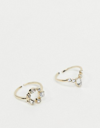 Pieces ring with embellished gem stones in gold