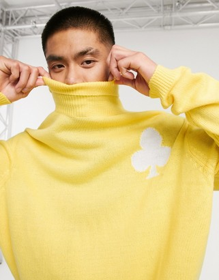 ASOS DESIGN knitted oversized funnel neck sweater with club design in yellow