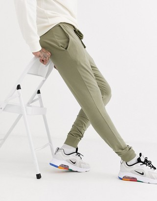 Asos Design DESIGN lightweight super skinny joggers in light khaki-Green