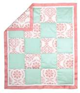 The Peanut Shell Medallion Patchwork Quilt in Coral/Mint