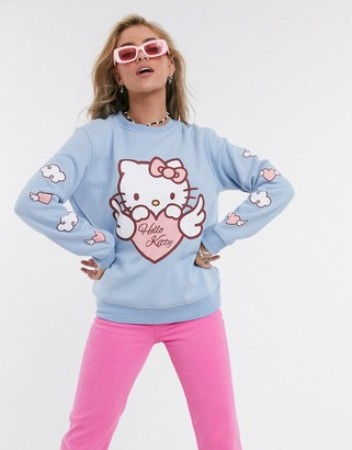 New Girl Order x Hello Kitty oversized sweatshirt in baby blue with angel kitty graphics