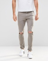 Asos Super Skinny Jeans With Knee Rips In Grey