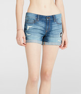Medium Wash Rip-And-Repair Denim Midi Shorts