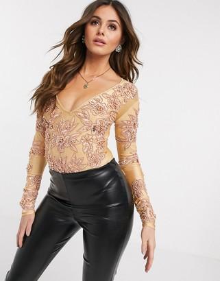 A Star Is Born embellished plunge bodysuit in rose gold