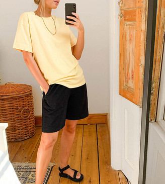 ASOS DESIGN relaxed t-shirt with roll sleeve in lemon