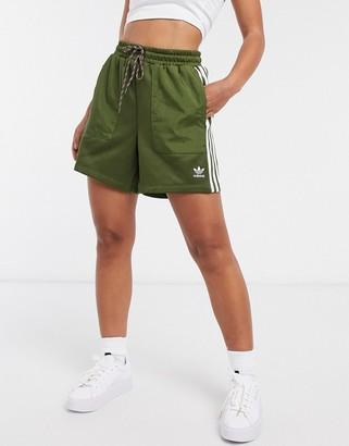 adidas Bellista three stripe ripstop shorts in khaki