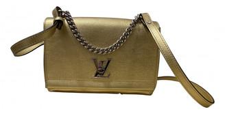 Louis Vuitton Lockme Gold Leather Handbags