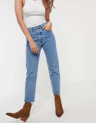 Levi's 501 crop jeans in midwash blue