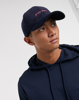 ASOS DESIGN baseball cap in navy cord with text embroidery