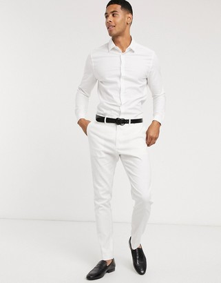 ASOS DESIGN wedding skinny suit trousers in stretch cotton linen in white