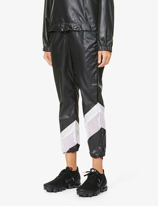 Koral Adai Vento tapered-leg mid-rise shell trousers