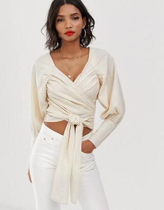 Asos DESIGN textured long sleeve top with wrap around waist detail