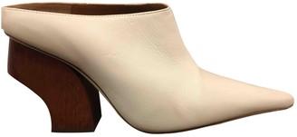 REJINA PYO Ecru Leather Mules & Clogs