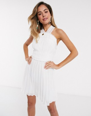 ASOS DESIGN halter neck ruched waist mini dress with pleat skirt