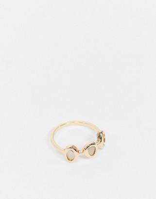 ASOS DESIGN thumb ring with semi precious stones in gold tone