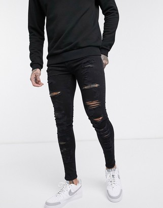 Topman super spray on jeans with ladder knee rip in black