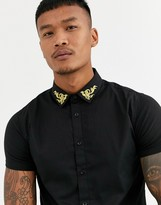 SikSilk muscle fit short sleeve shirt in black with gold collar detail