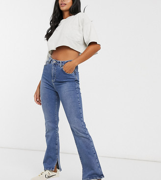 ASOS DESIGN Petite high rise '00's' stretch flare jeans in midwash