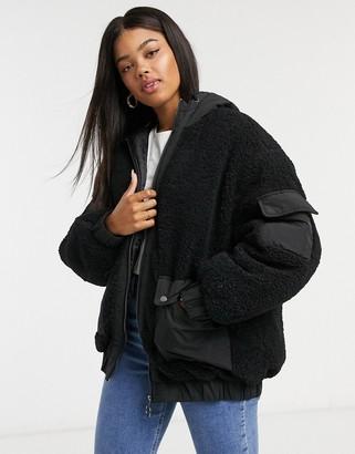 ASOS DESIGN fleece patched bomber jacket in black