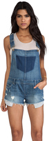 uncategorized  Who made Nina Dobreve blue denim romper?