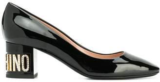 Moschino embellished logo heel pumps
