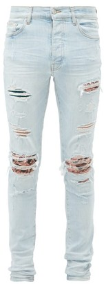 Amiri Distressed Printed-patch Skinny-leg Jeans - Blue