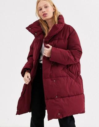Monki longline puffer jacket in burgundy