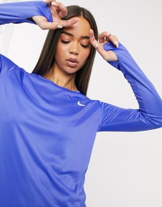 Nike Running Miler long sleeve top in purple