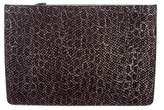 Alaia Embossed Leather Clutch