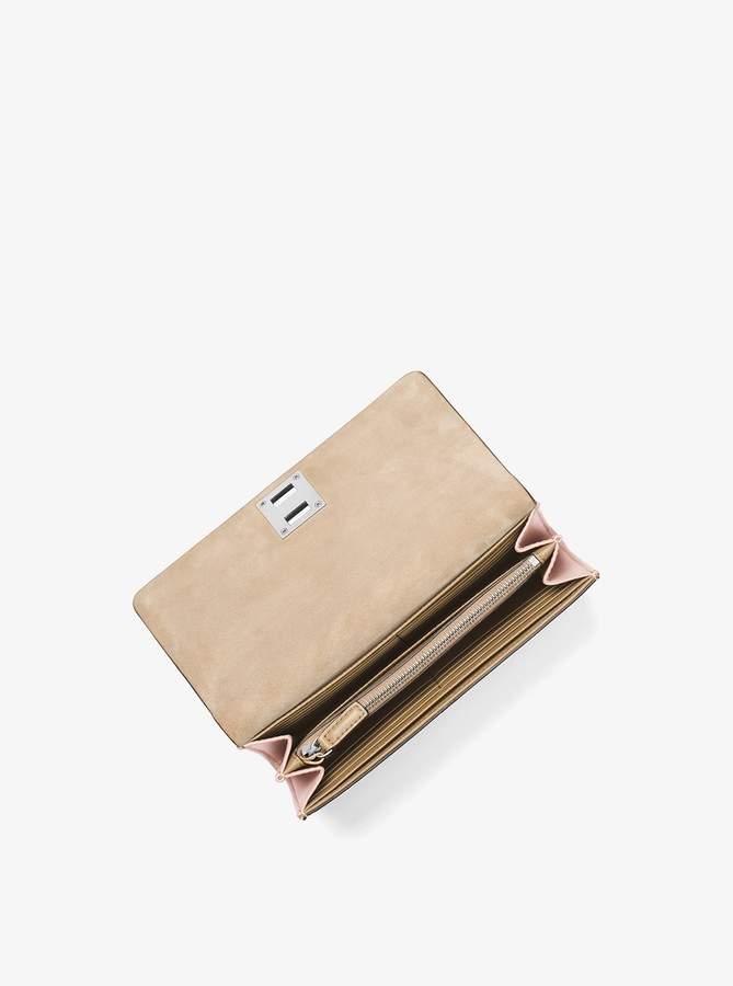 3719687b10d1 Michael Kors Lock Wallet - ShopStyle