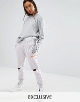 Ellesse Relaxed Joggers With Knee Rips