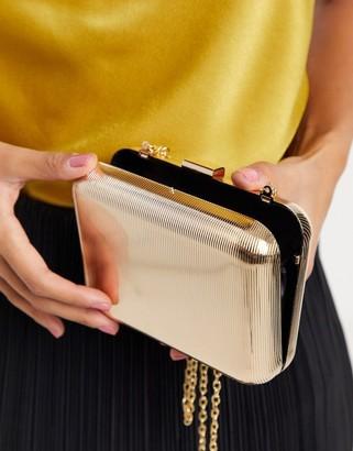 True Decadence clutch bag embossed gold metal box