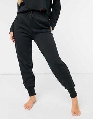 Nike Tech Fleece trackie in black