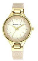 Anne Klein Women's AK/1408CRCR Swarovski Crystal Accented Cream Bangle Watch