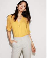 Express two pocket zip front shirt