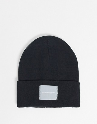 ASOS DESIGN oversized beanie in black with woven label
