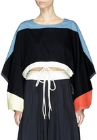Chloé Oversized knotted cuff drawstring cropped twill top