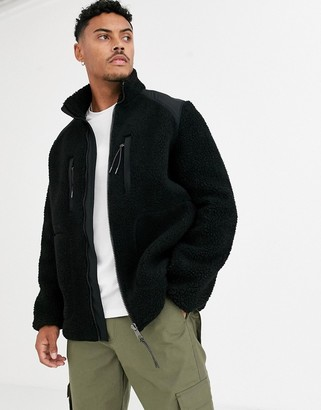 ASOS DESIGN borg jacket with contrast panel in black