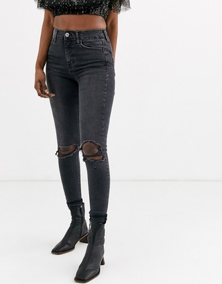 Topshop Jamie skinny jeans with rip knees in black