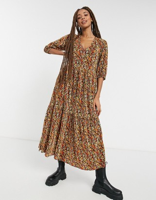 ASOS DESIGN plisse v neck maxi with tiered hem with long sleeves in autumnal floral