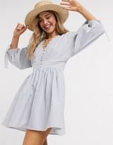 Asos Design DESIGN button neck mini smock dress with tie sleeves in navy white stripe
